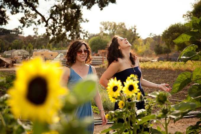 women-laughing-amid-sunflowers