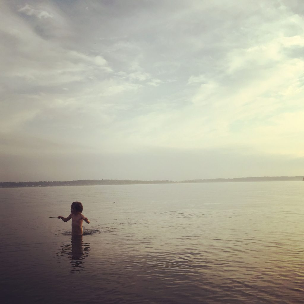 boy-wading-in-water