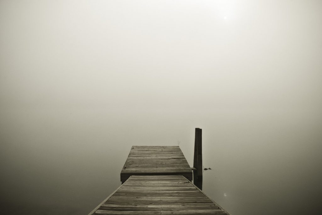 dock-in-fog-water