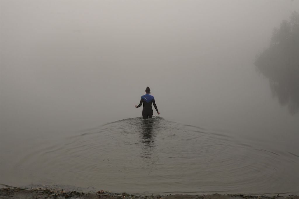 woman in sea in fog
