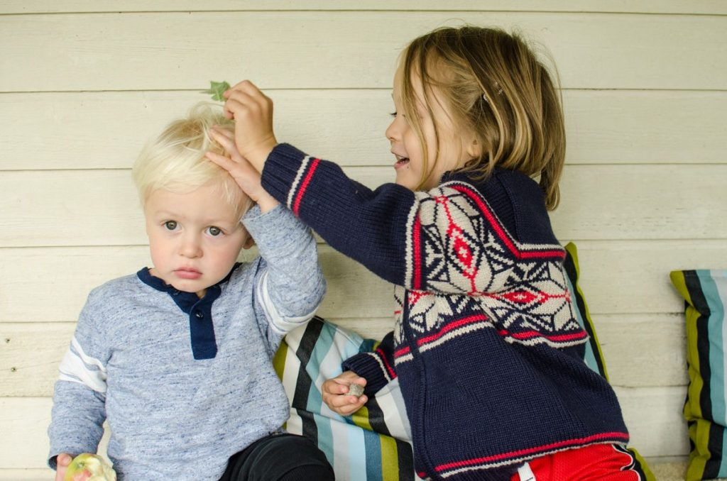 August putting a leaf on Leif's head