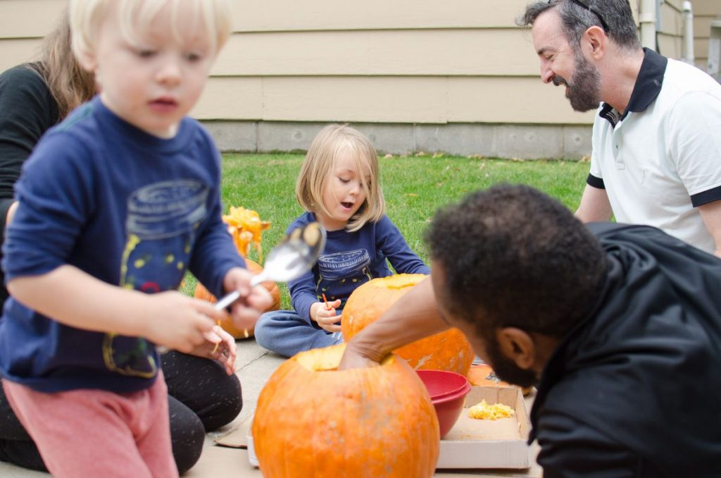 Carving pumpkins with uncles