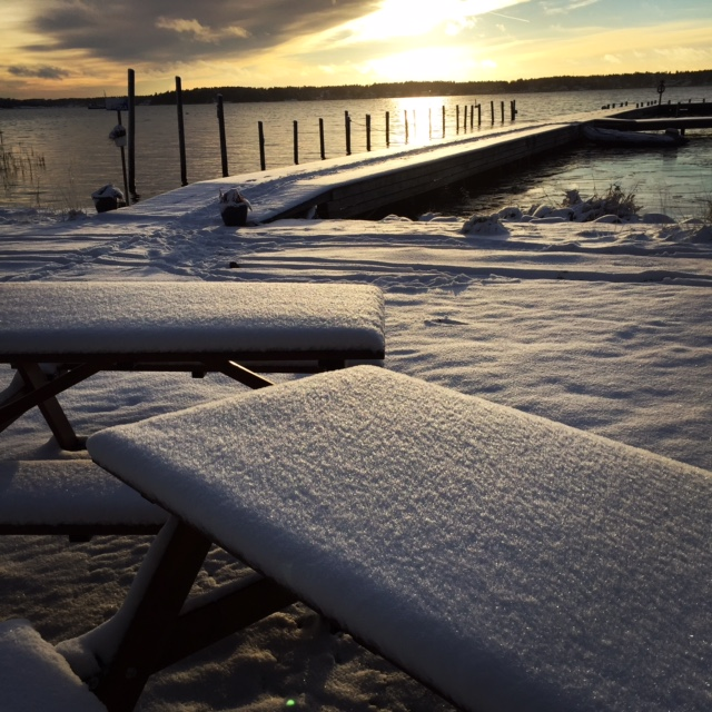 Afternoon sunlight on a snow covered picnic table
