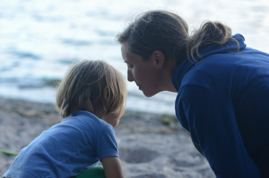 Mama and August at beach in profile