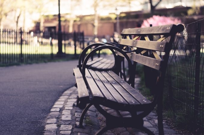 Empty bench in park by James Pond