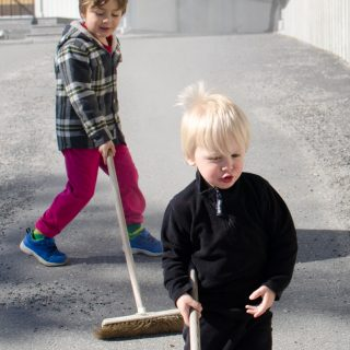 Boys sweeping the street
