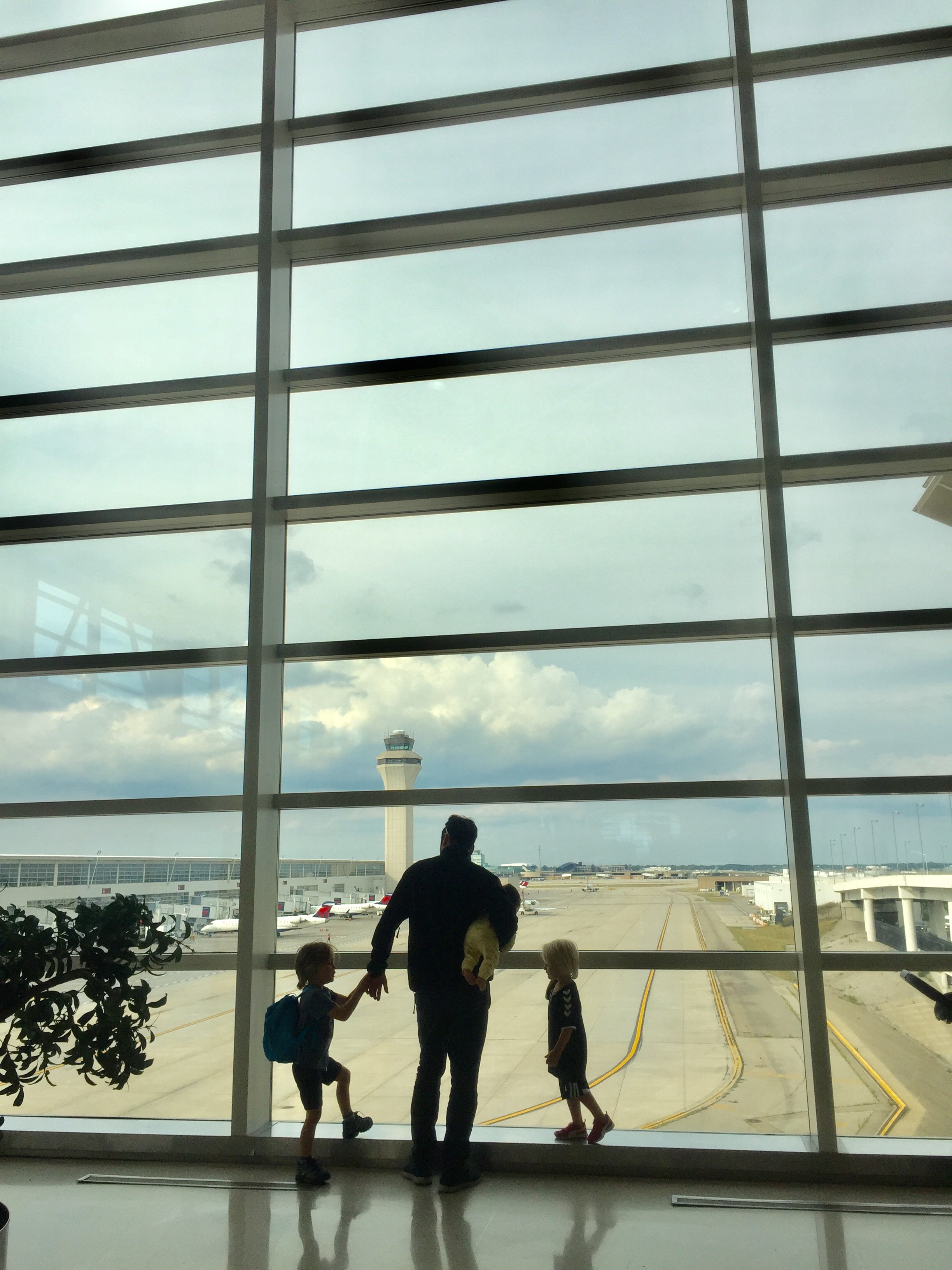 James with the kids looking out airport window