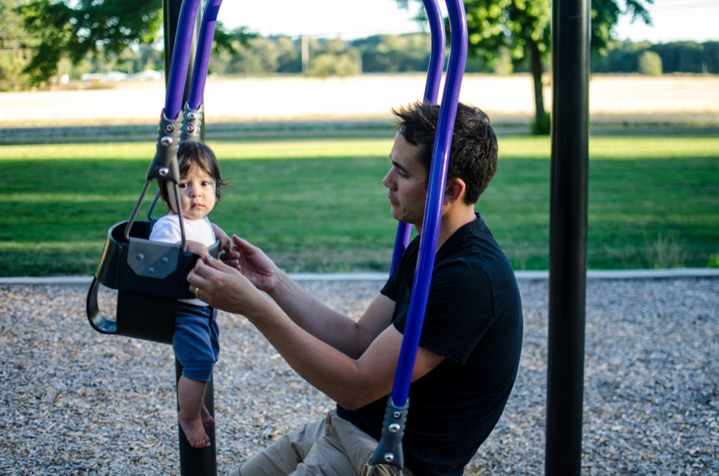 Baby and James swinging