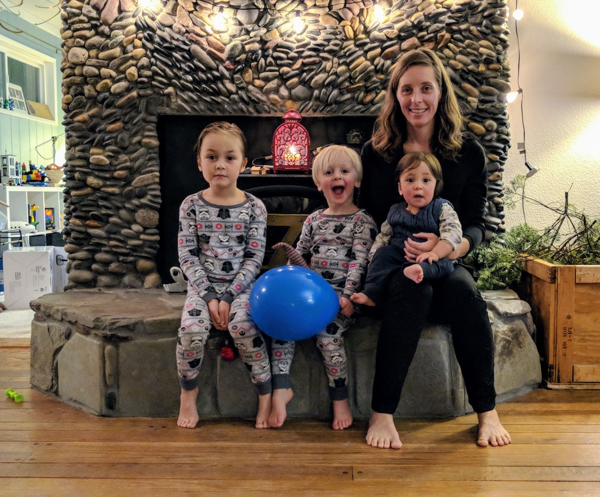 Jodi and kids sitting at fireplace