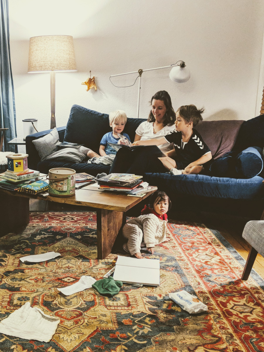 Mom and kids on couch reading