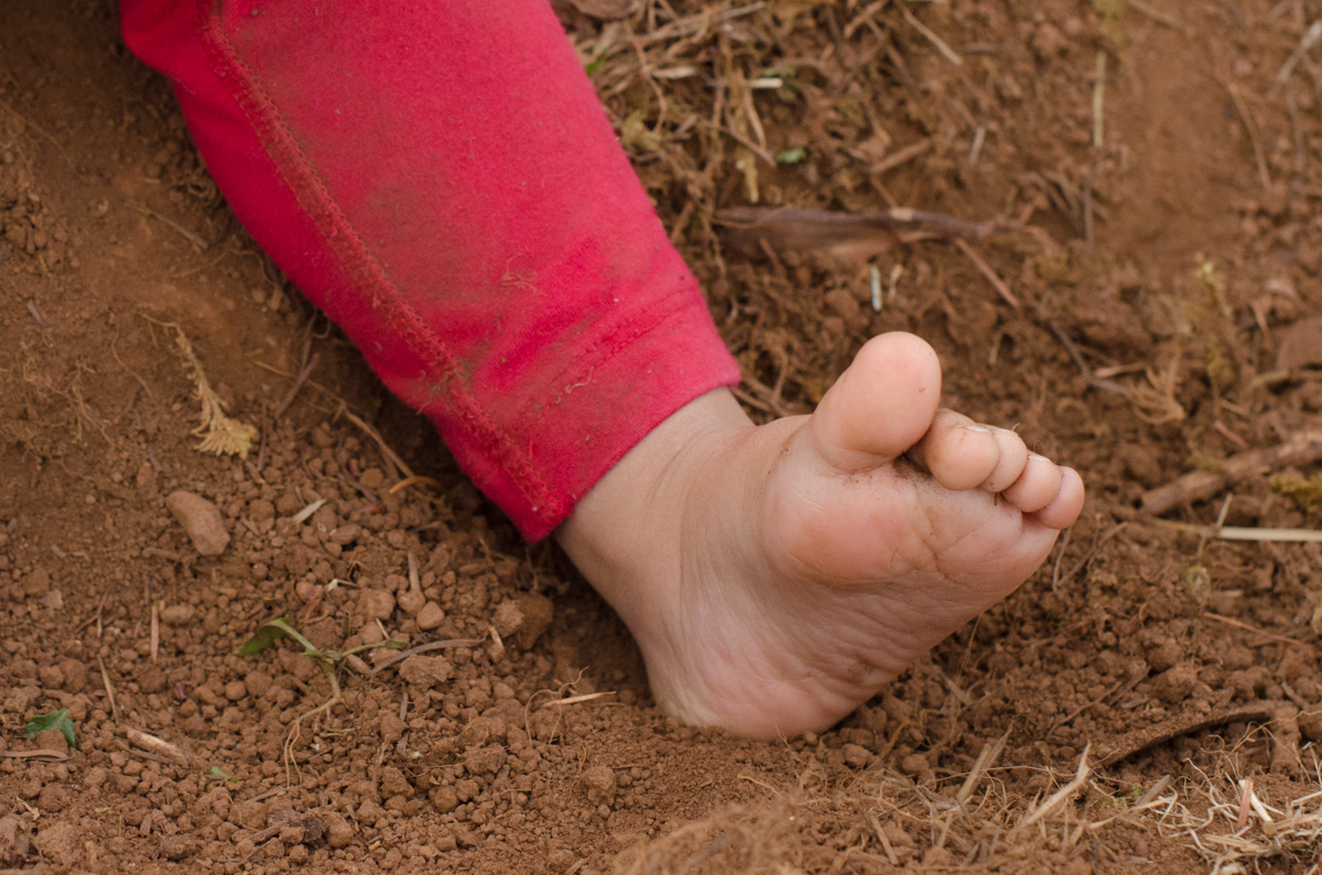 Bare foot in the dirt