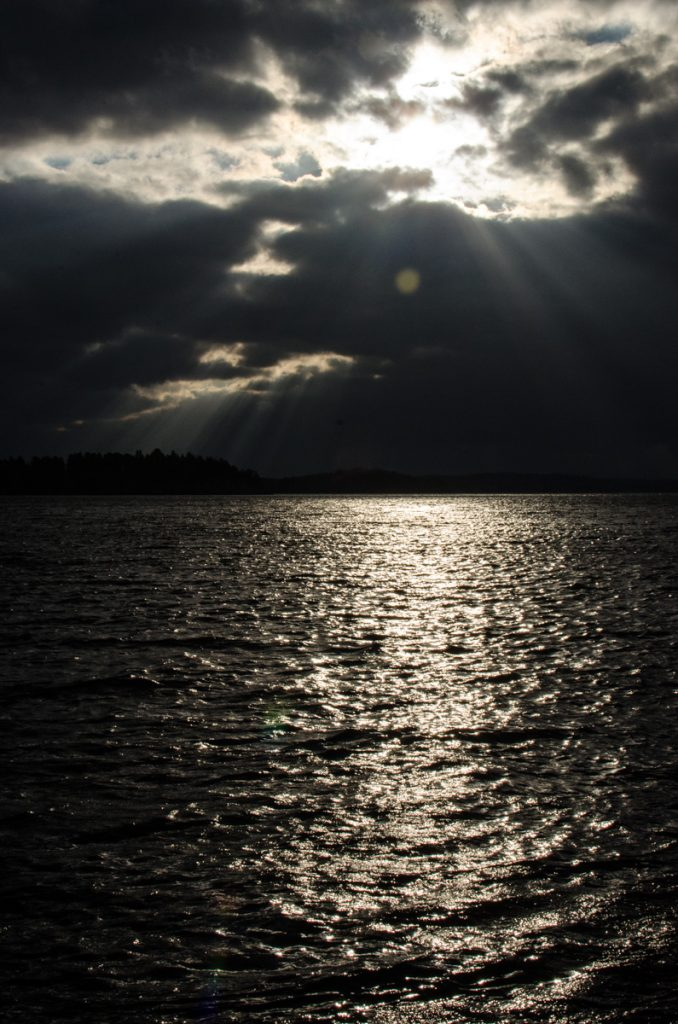 Moody sun rays on sea