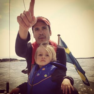father-son-sailing-pointing