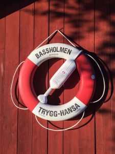 red-life-preserver-on-red-wall