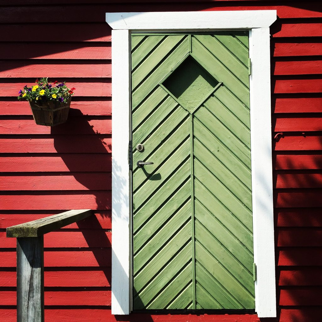 green-door-red-wall-flowers