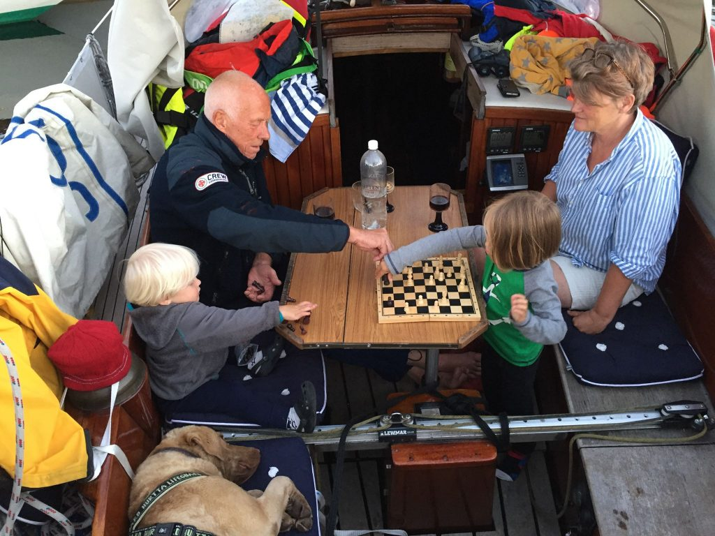 boys-playing-chess-with-grandparents