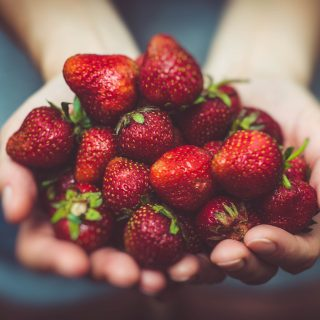 hands-holding-strawberries