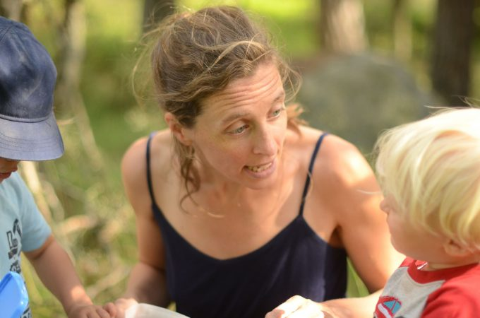 unkempt-mama-talking-to-baby-picking-blueberries