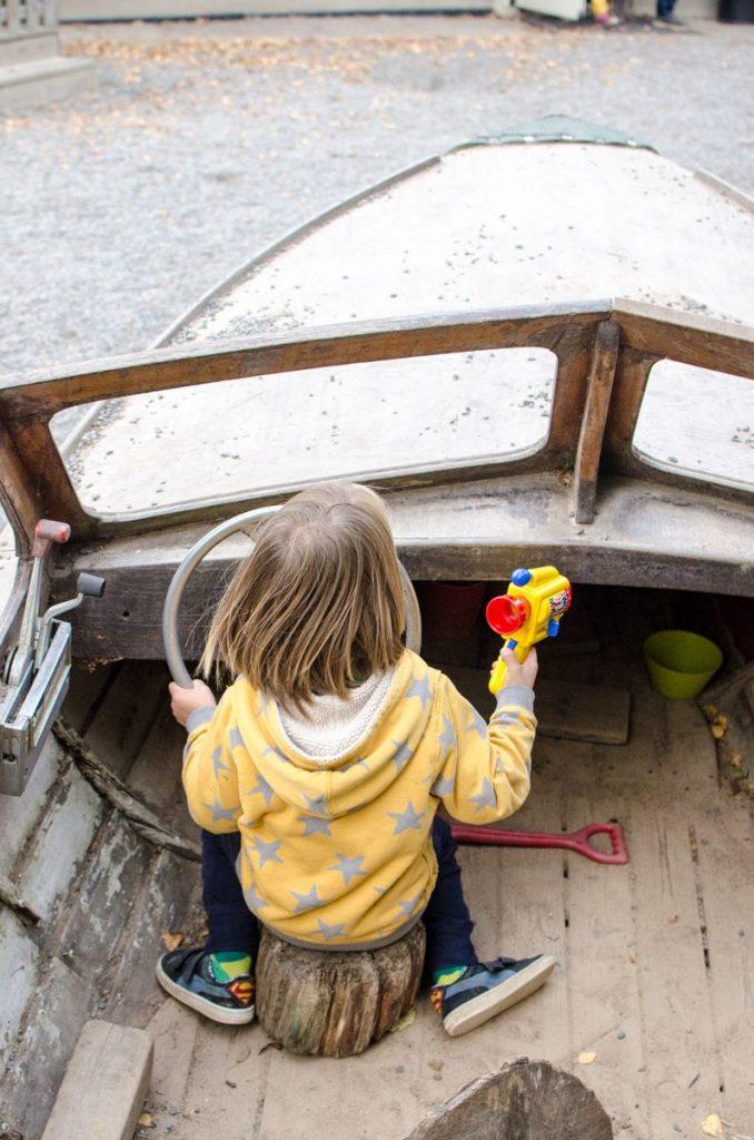 boy-playing-in-boat-preschool-in-sweden