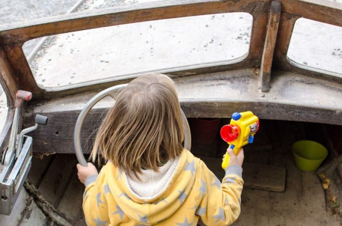 boy-playing-in-boat-preschool-in-sweden