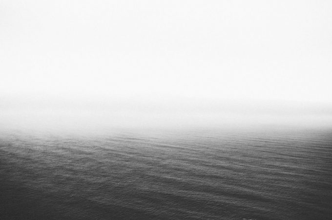 black and white sea with fog