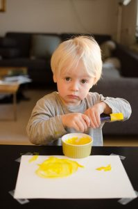 Leif painting with yellow