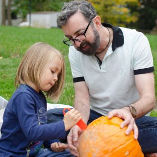 August and Lee carving a pumpkin