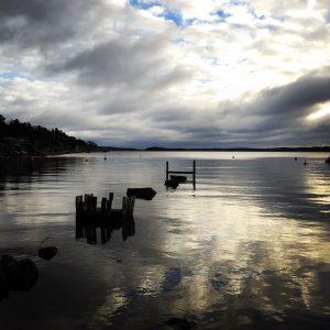 Abandoned dock cloudy sky