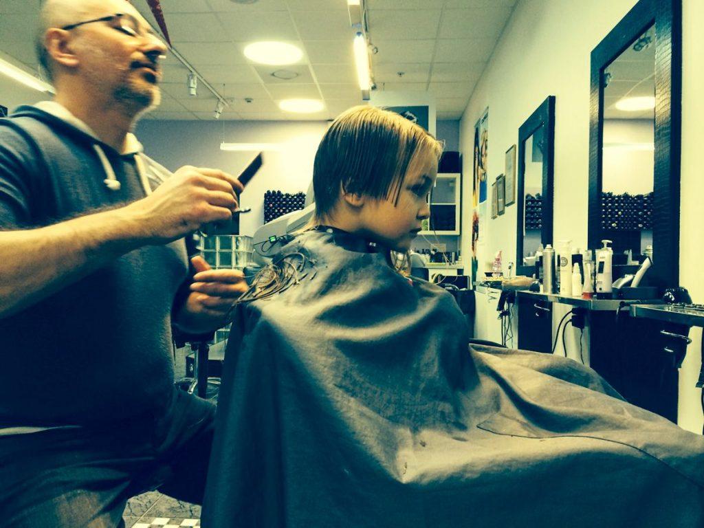 August getting haircut