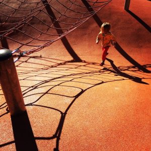 August running on orange playground