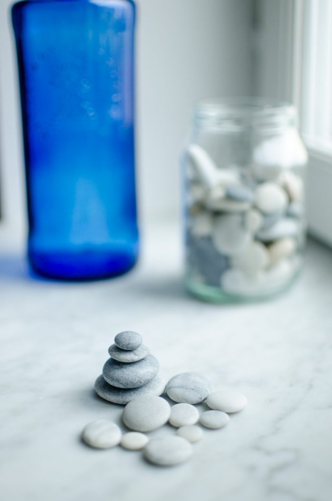 Blue bottle and rock cairn