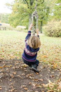 August on rope swing and happiness