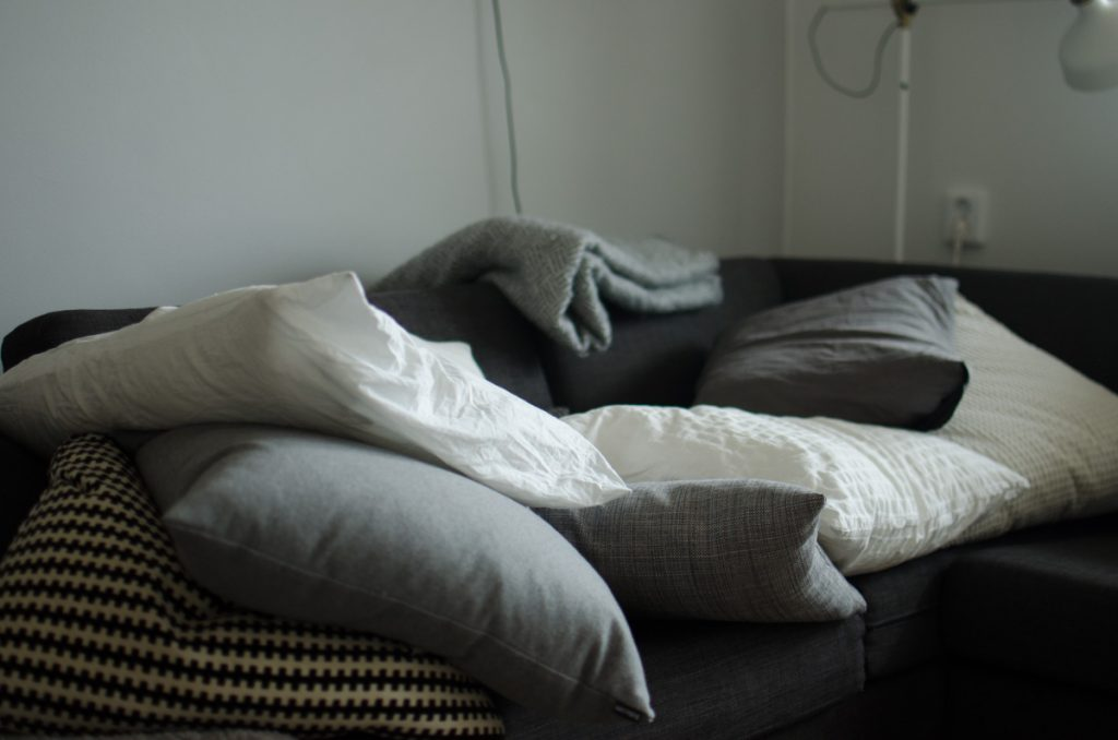 Grey and white pillows on couch