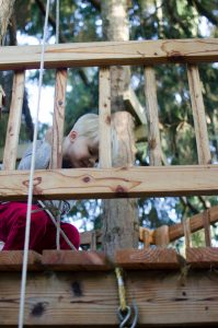 Leif playing in treehouse