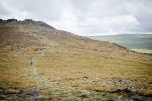 Small boy in the distance hiking Dartmoor