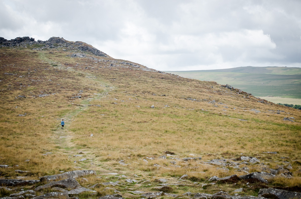 Small boy in the distance hiking Dartmoor