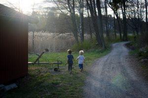 Boys running at dusk