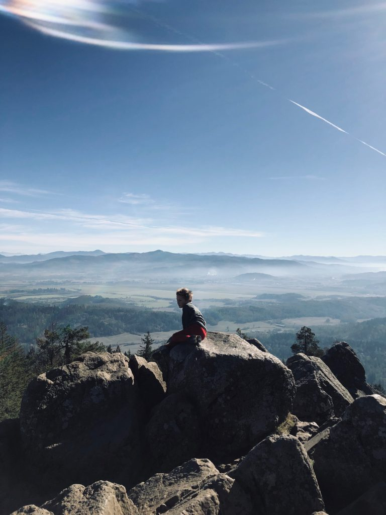 Boy at top of Spencer Butte