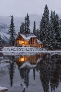 Solitary cabin in winter, we are all islands